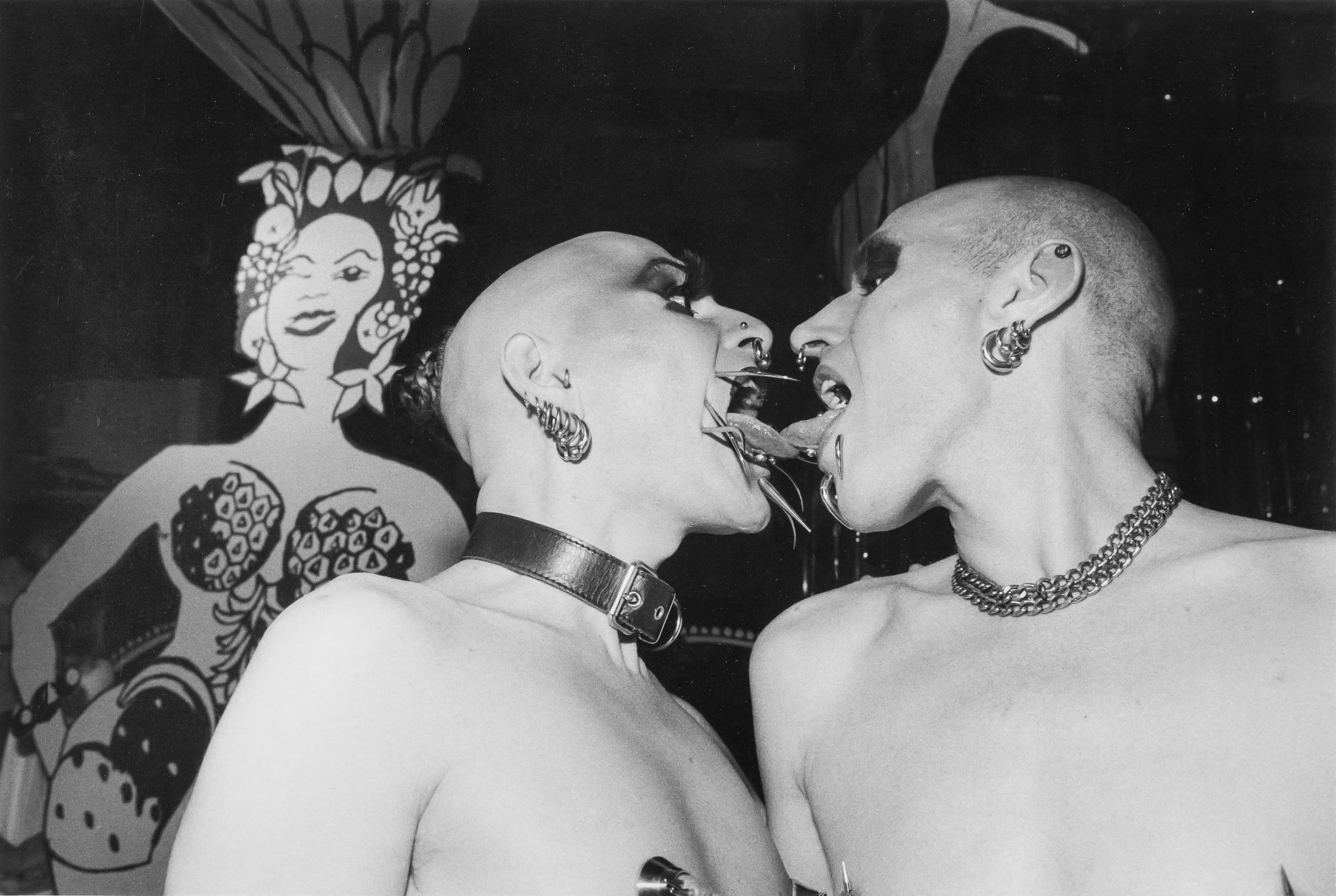 Barbara Alper- Photo of LGBT+ Men Kissing with steel Whiskers at the Safer Planet Sex Ball, London