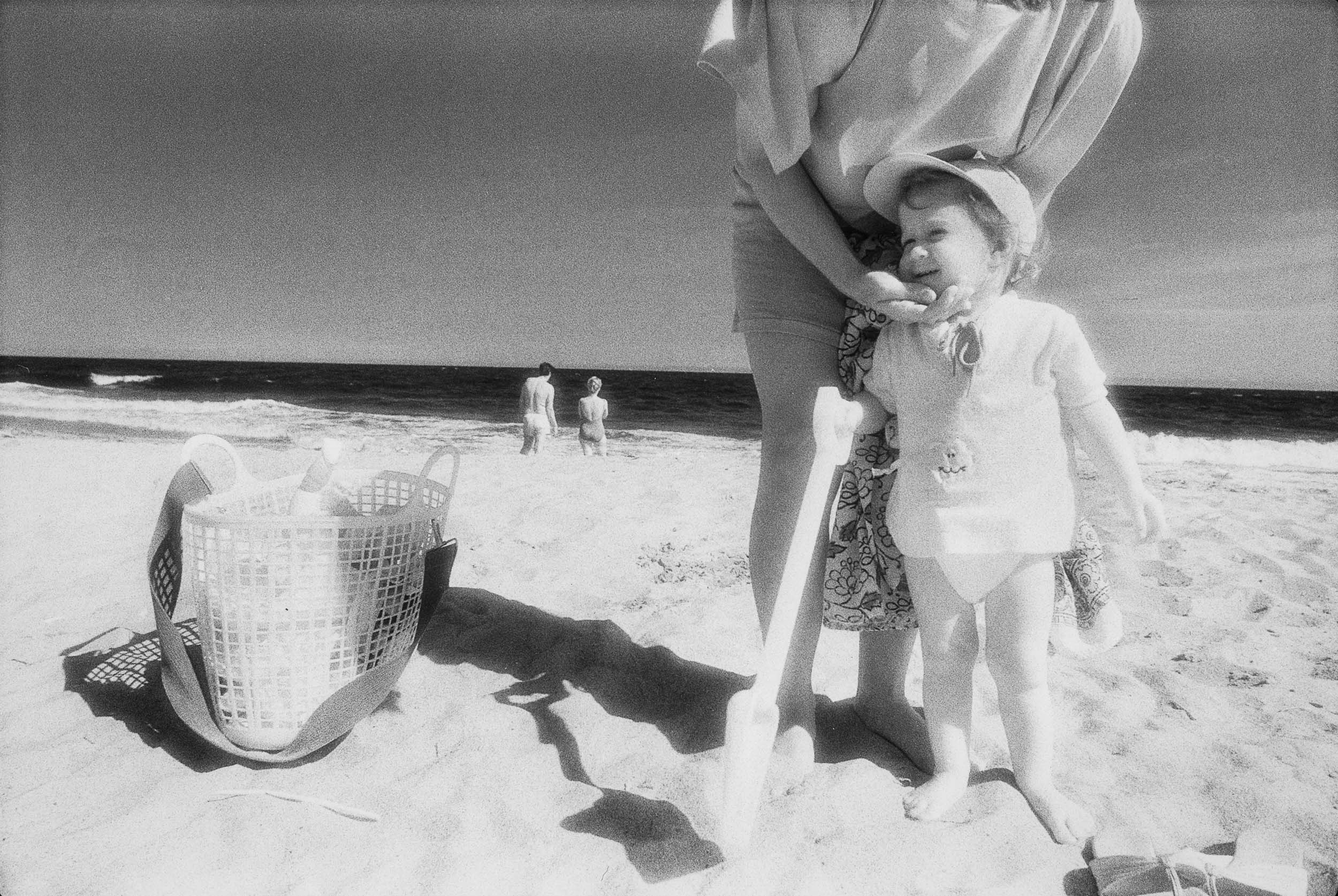 Barbara Alper- Photo of little boy with a shovel on Rockaway Beach NYC