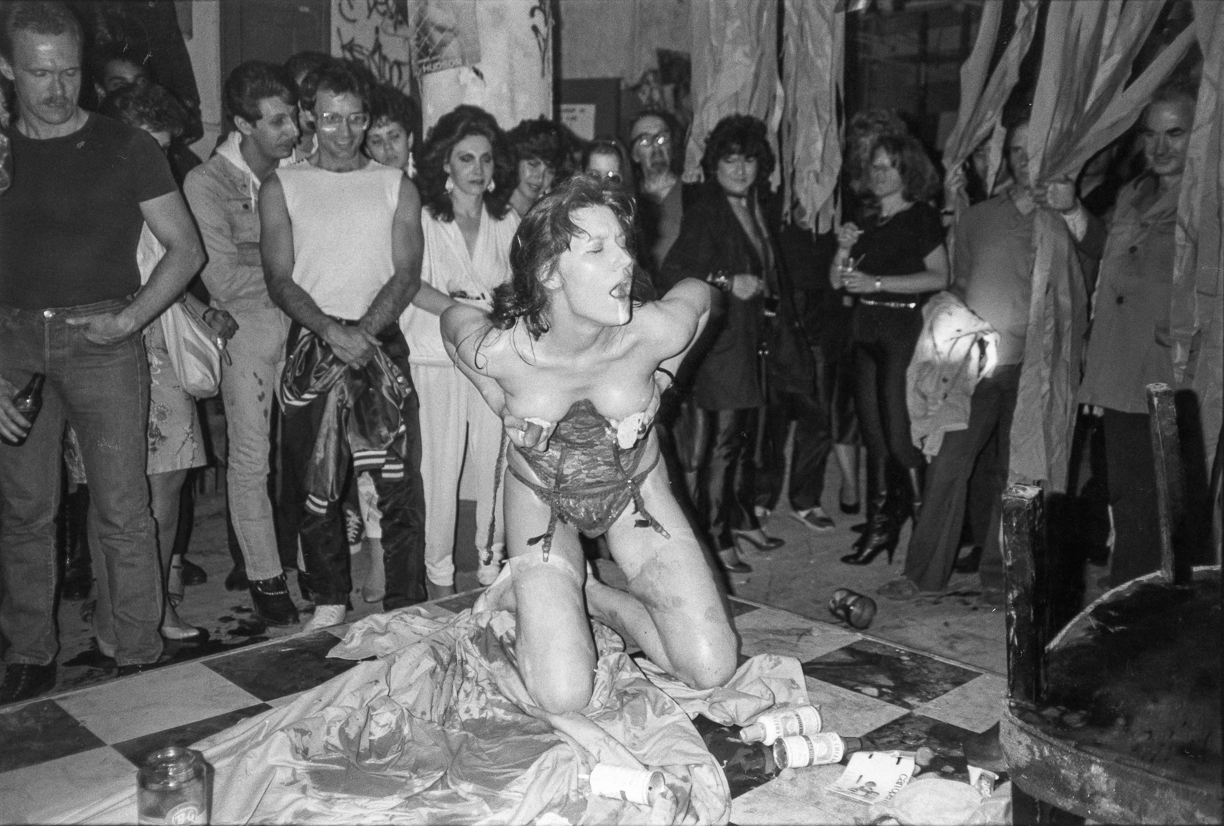 Barbara Alper- Photo of women performing with Cheez Whiz at sex party at Danceteria, NYC