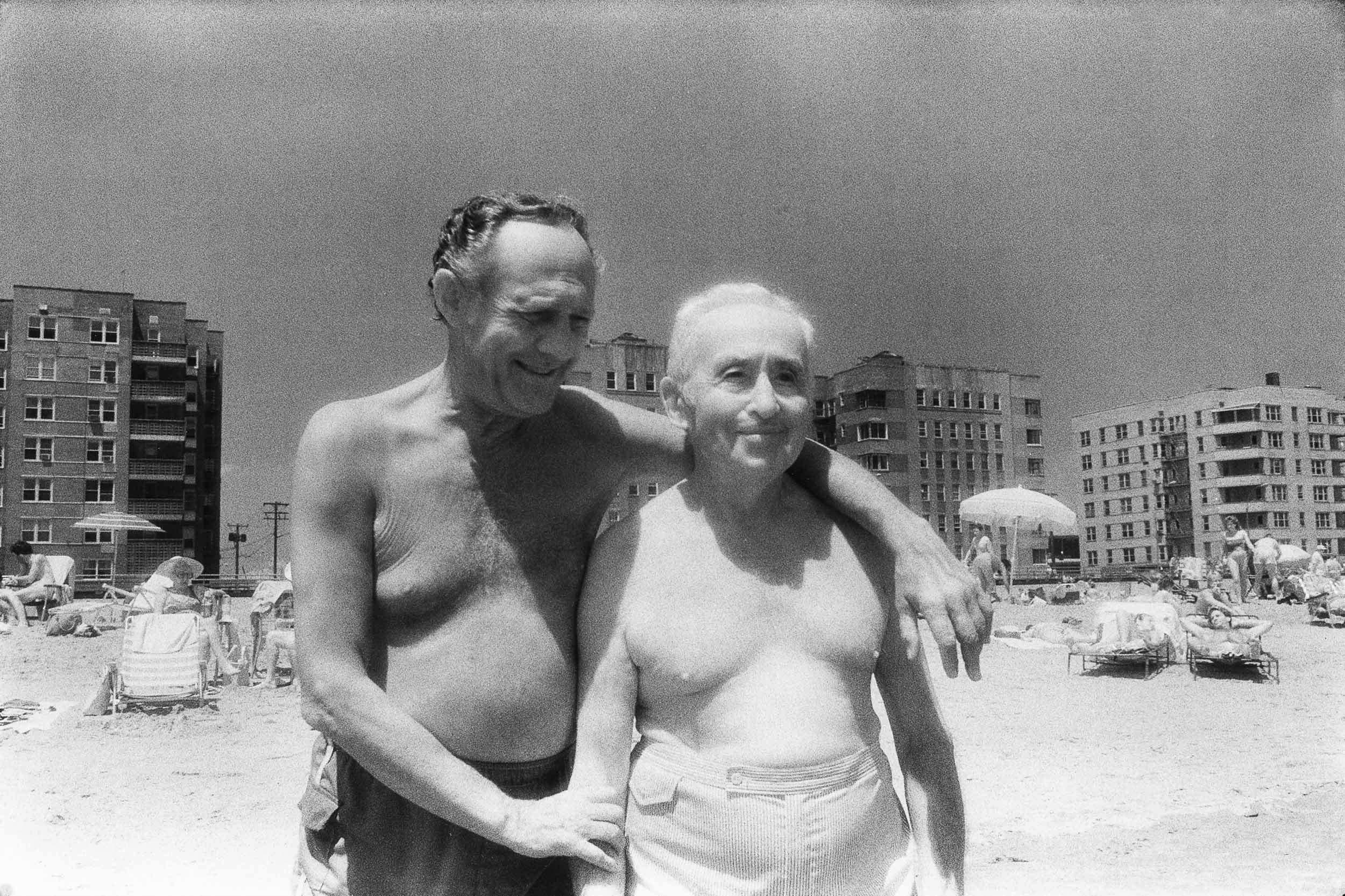 Barbara Alper- Photo of two men as friends on Rockaway Beach NYC